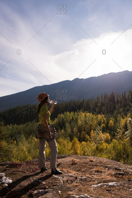 Thirsty hiker drinking water on a sunny day