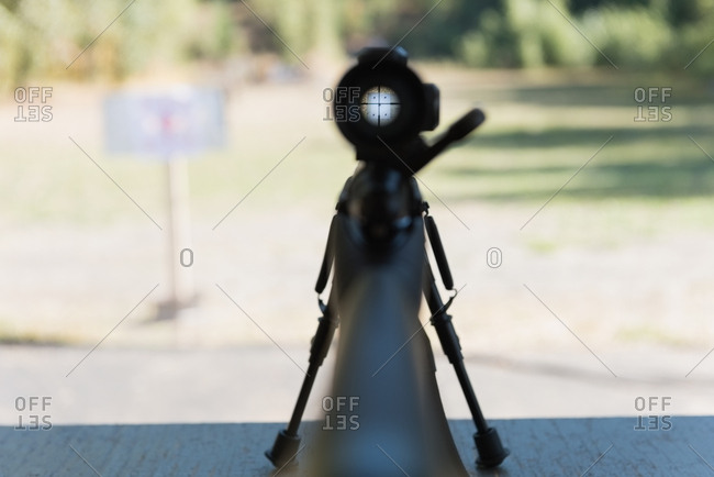 Sniper rifle aiming at target