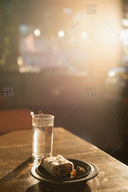 Breakfast and glass of water on table
