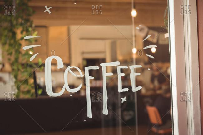 Word coffee written on entrance door
