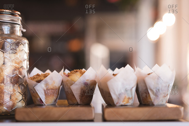 Close-up of muffins on wooden board