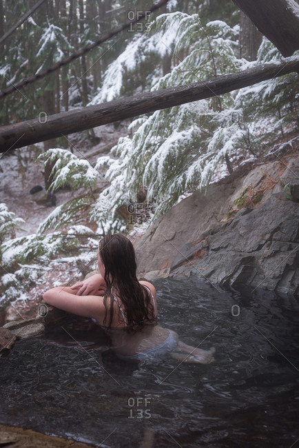 Attractive woman relaxing in hot spring