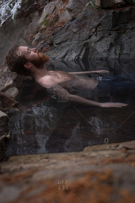 Handsome man relaxing in hot spring