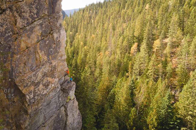 Mountaineer climbing the rocky cliff