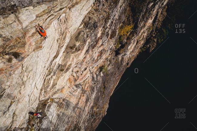 Rock climber climbing a rocky cliff