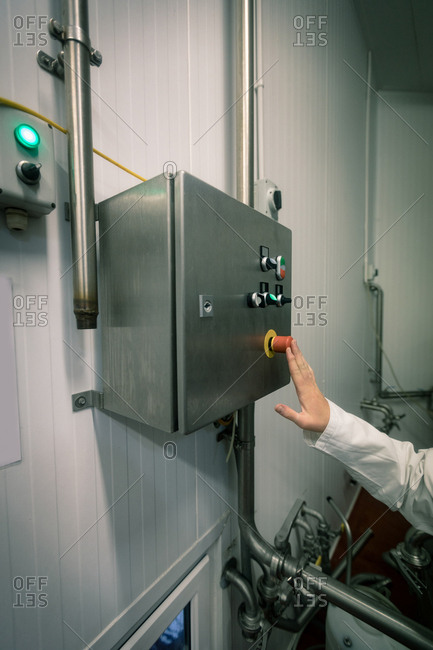 Worker pressing the control switch