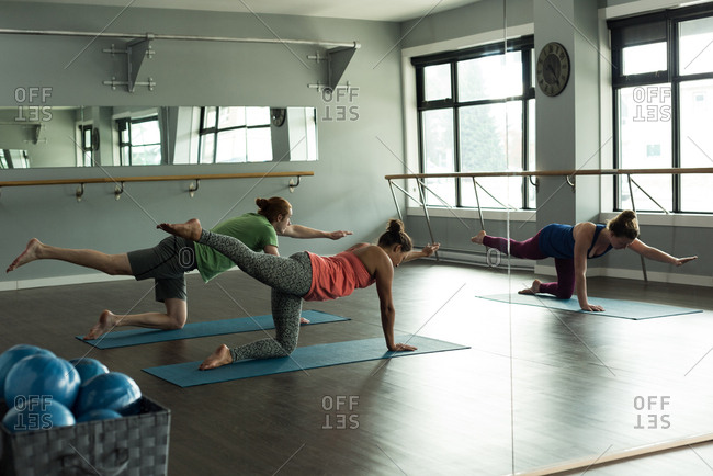Group of fit people practicing yoga