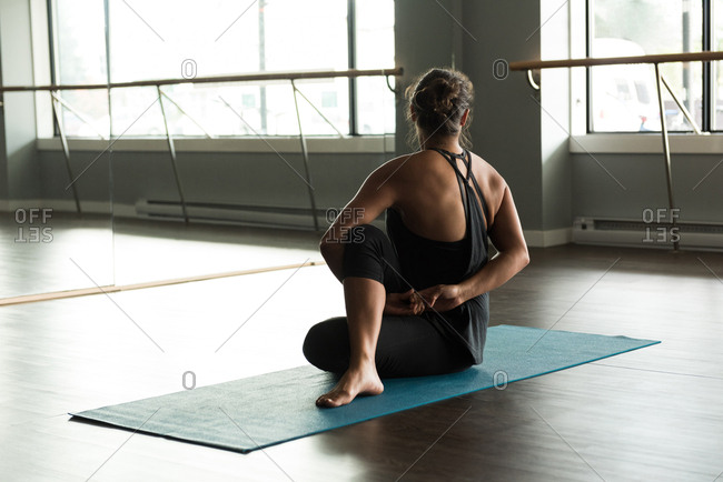 Woman practicing stretching exercise