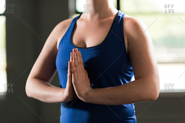 Mid section of woman practicing yoga