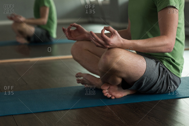 Low section of man practicing yoga