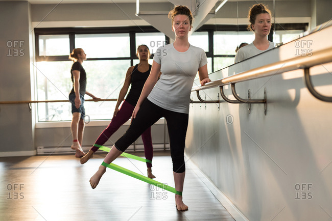 Women exercising with resistance band