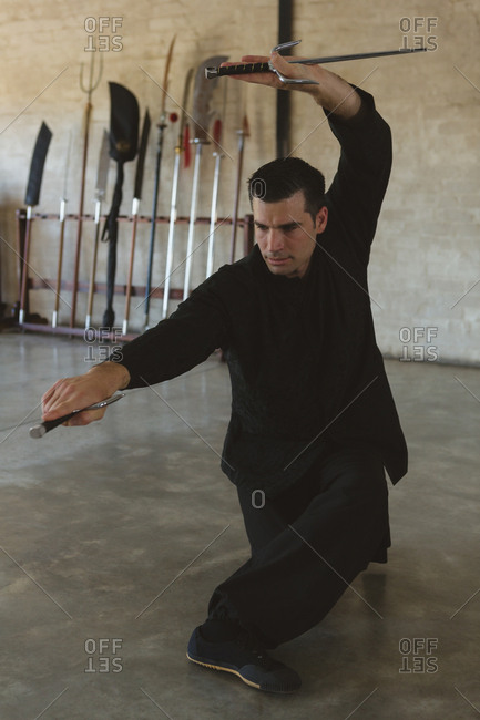 Kung fu fighter practicing martial arts