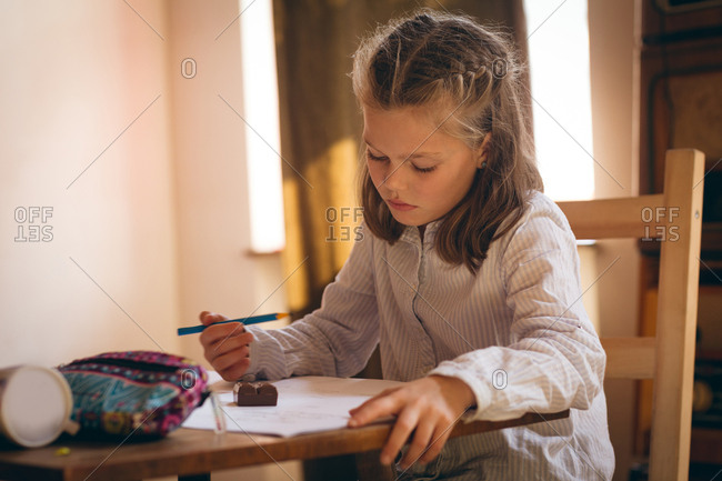Girl doing her homework at home