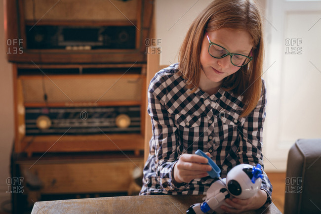 Girl fixing the robotic toy