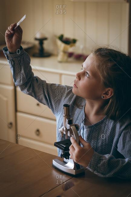Girl examining the glass slide