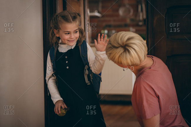 Daughter going to school and saying goodbye to her mother