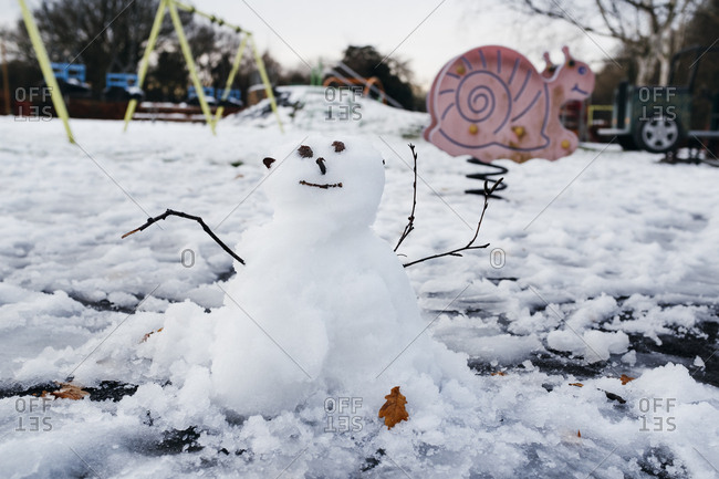 Little snowman in playground