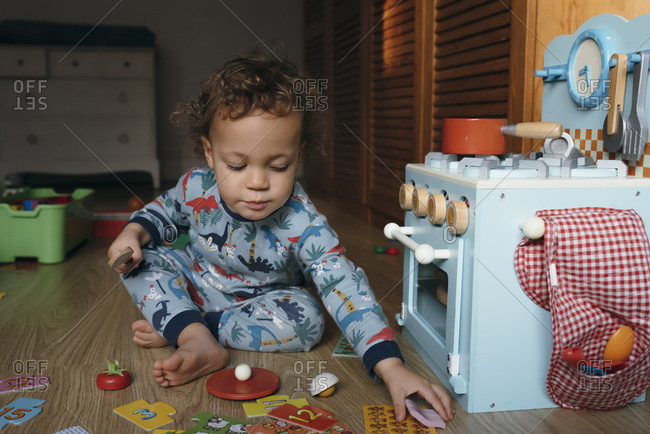 Boy plays with wooden food set