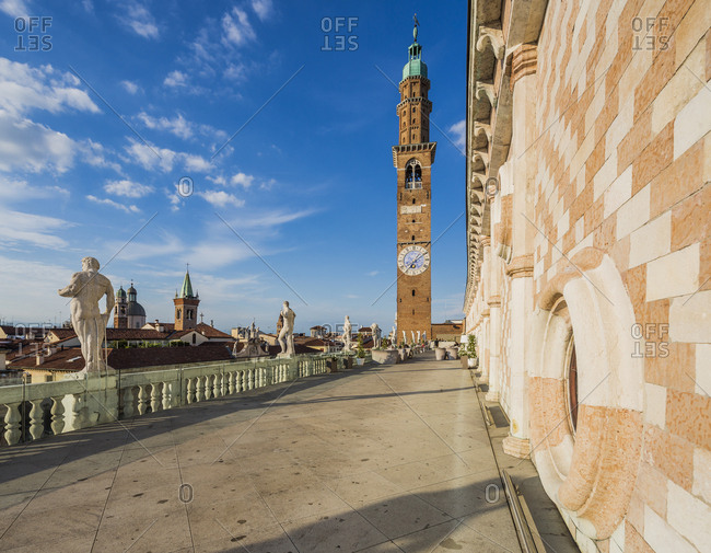 Italy, Veneto, Vicenza . Piazza dei Signori, the terrace of Basilica Palladiana (Palladio architect), Torre Bissara and the bell tower and the dome of the Chiesa di San Vincenzo on the background