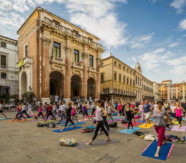 December 19, 2017: Italy, Veneto, Vicenza . Piazza dei Signori, yoga lesson, the Loggia del Capitaniato on the background