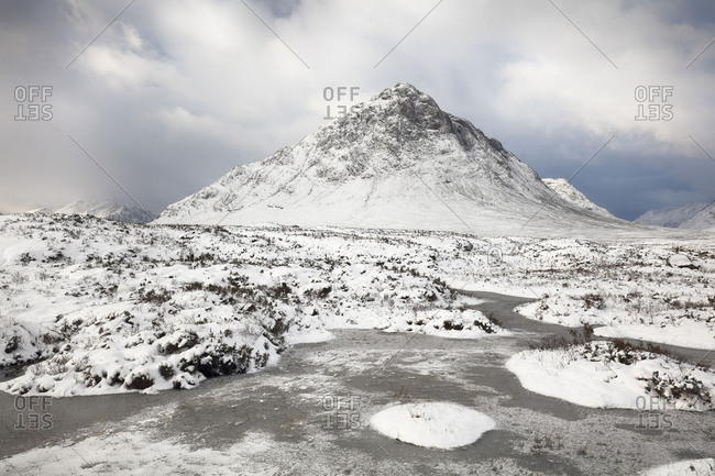 Buachaille Etive Mor mountain on a snow-covered landscape in the Scottish highlands, Glencoe, Scotland