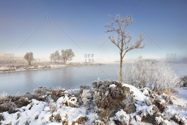 A frozen Loch Ba on a snow-covered misty winter morning, Rannoch Moor