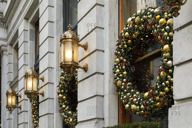 Christmas wreathes hung on windows of building in New York City
