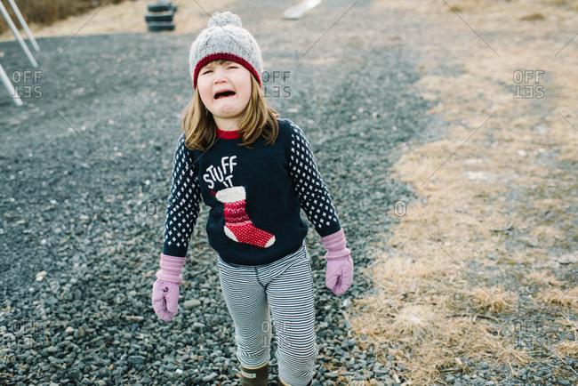 Crying girl wearing Christmas sweater