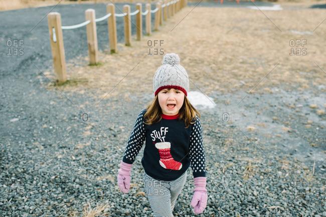 Upset girl wearing Christmas sweater