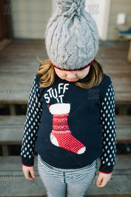 Frowning girl wearing a Christmas sweater