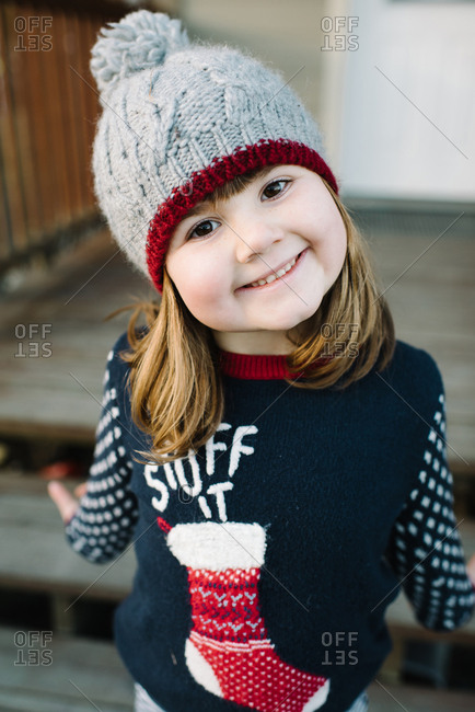 Smiling girl wearing a Christmas sweater