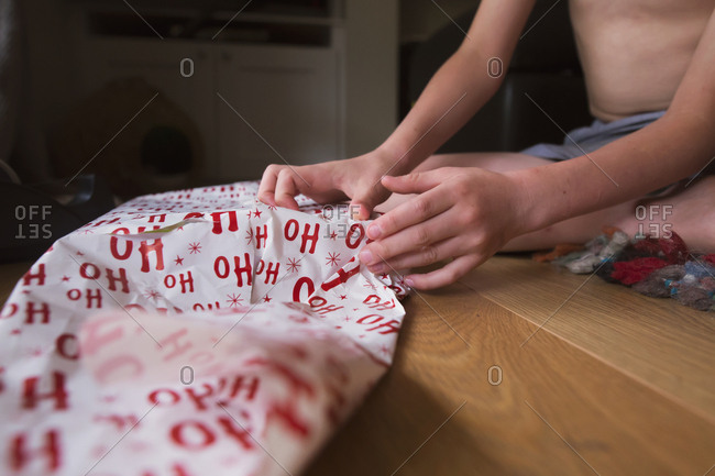 Boy wrapping a Christmas present