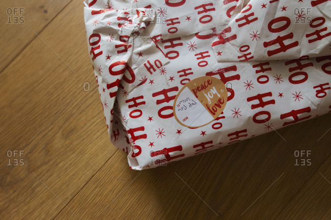 Christmas present wrapped by a child for parents