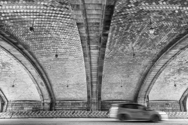 New York City, New York - January 6, 2017: Car driving on a path under the Ed Koch Queensboro Bridge