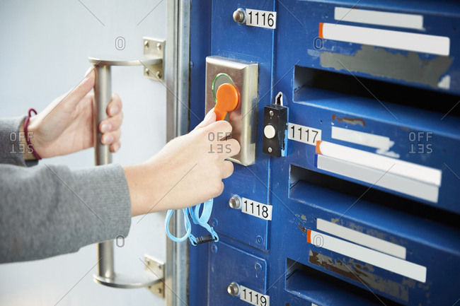 Cropped image of student unlocking door with cardkey at university
