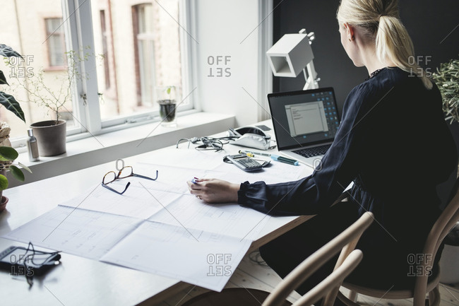 Female engineer working on desk at home office