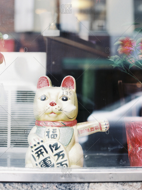Lucky cat figurine in window