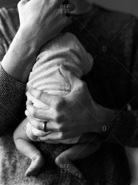 Closeup portrait father holding newborn