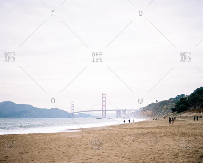 Foggy bridge view from sandy beach