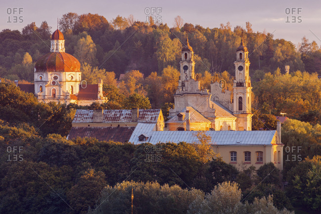 Lithuania, Vilnius, morning view of churches among trees