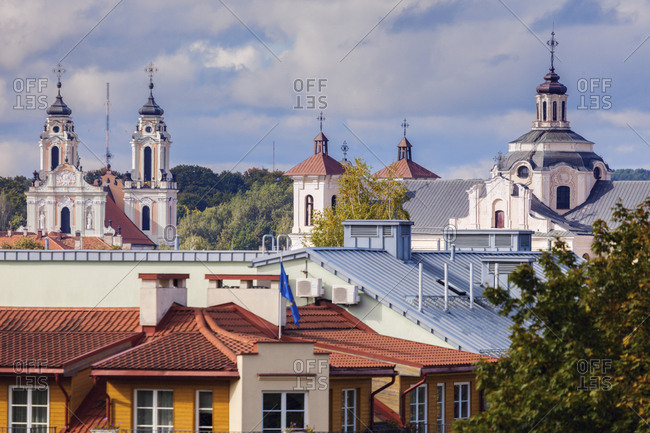 Lithuania, Vilnius, Residential building with churches in background