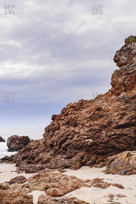 Australia, New South Wales, Rock formation on sandy beach