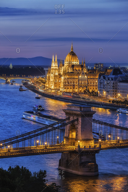 Hungary- Budapest- tranquil evening in the city with lit up Hungarian Parliament and Chain Bridge on Danube River
