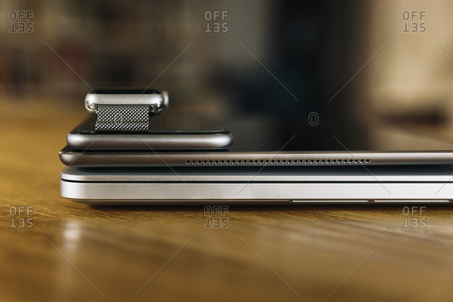 Stack of mobile devices on table top