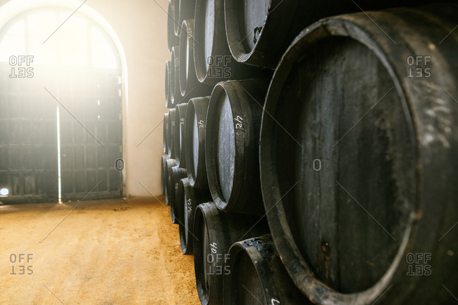 Stack of old casks in a cellar