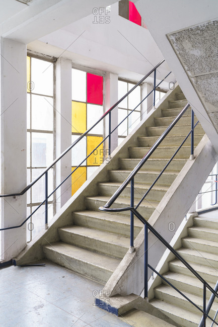 Staircase with colorful windows in an old building