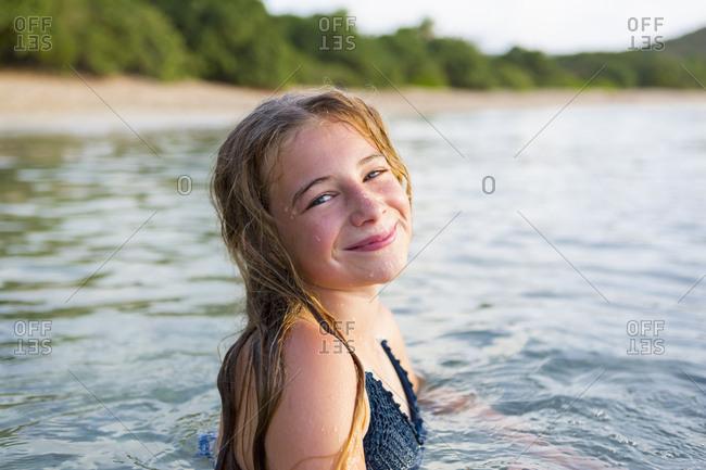 Portrait of smiling Caucasian girl swimming