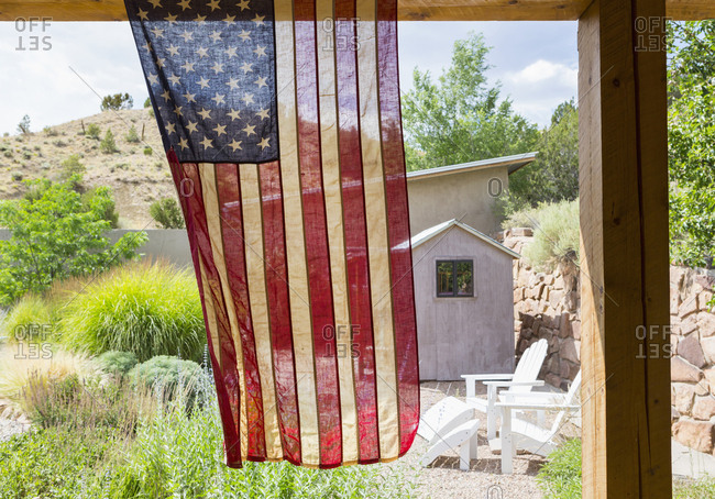 American flag hanging in backyard