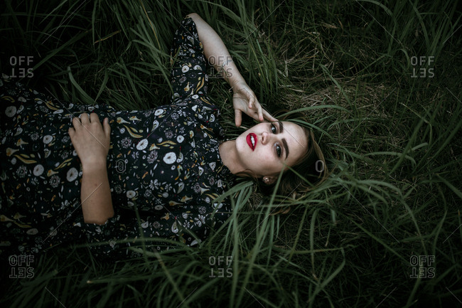 Caucasian woman laying in grass