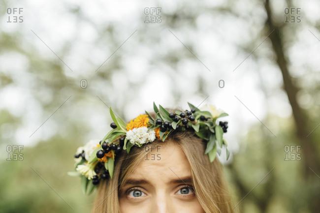 Eyes of Middle Eastern woman wearing flower crown